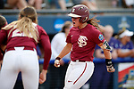 OKLAHOMA CITY, OK - JUNE 04: Anna Shelnutt #13 of the Florida State Seminoles celebrates her home run against the Washington Huskies during the Division I Women's Softball Championship held at USA Softball Hall of Fame Stadium - OGE Energy Field on June 4, 2018 in Oklahoma City, Oklahoma. (Photo by Shane Bevel/NCAA Photos via Getty Images)