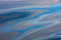 Norway, Svalbard, colourful reflections on water, abstract