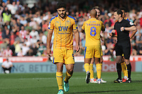 Sam Morsy walks towards the Wigan dressing room after being sent off, as referee, Mr Darren England, puts the red card back into his pocket during Brentford vs Wigan Athletic, Sky Bet EFL Championship Football at Griffin Park on 15th September 201