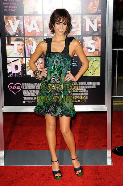 "JESSICA ALBA.The Los Angeles World Premiere of  ""Valentine's Day"" at Grauman's Chinese Theatre in Hollywood, California, USA..February 8th, 2010 .full length dress green platform sandals blue ankle strap open toe navy gold bangles bracelets sleeveless black feather feathers beaded peacock  hands on hips .CAP/ROT.©Lee Roth/Capital Pictures"