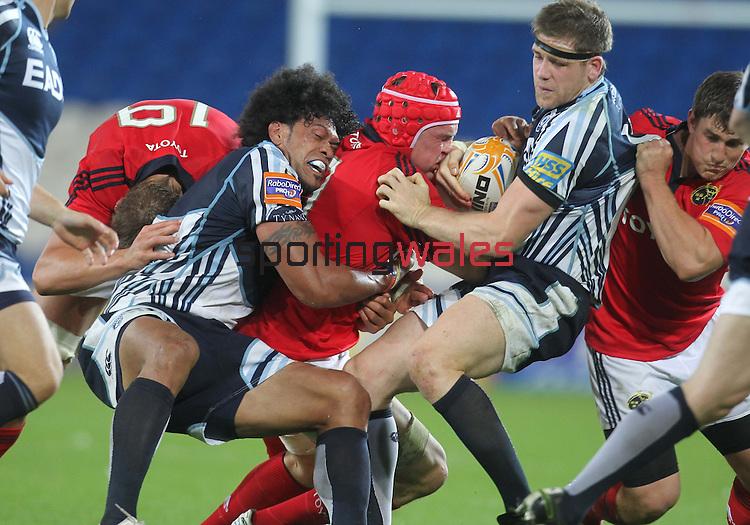 Rabo Direct Pro12.Cardiff Blues v Munster.No way through for Tommy O'Donnell as Maama Molitika and Gavin Evans close in...23.09.11.©Steve Pope