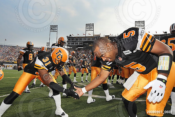 September 7, 2009; Hamilton, ON, CAN; Hamilton Tiger-Cats defensive back Jykine Bradley (31) and quarterback Kevin Glenn (5). CFL football - the Labour Day Classic - Toronto Argonauts vs. Hamilton Tiger-Cats at Ivor Wynne Stadium. The Tiger-Cats defeated the Argos 34-15. Mandatory Credit: Ron Scheffler.