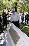 Bob Nylen poses with the newly restored memorial following the USS Nevada Centennial of Launch ceremony at the Capitol, in Carson City, Nev., on Friday, July 11, 2014.<br /> Photo by Cathleen Allison