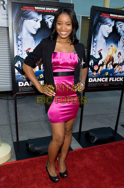 "KEKE PALMER .The Los Angeles Premiere of ""Dance Flick"" held at the Arclight Theatre, Los Angeles, California, USA..May 20th, 2009.full length pink silk satin dress black jacket hands on hips peep toe shoes.CAP/ADM/TC.©T. Conrad/AdMedia/Capital Pictures."