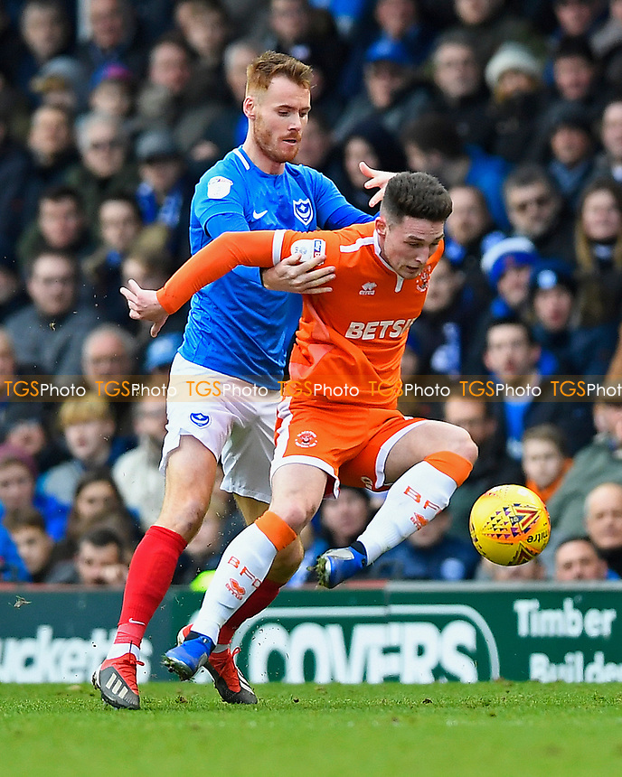 Jordan Thompson of Blackpool is held by Tom Naylor of Portsmouth during Portsmouth vs Blackpool, Sky Bet EFL League 1 Football at Fratton Park on 12th January 2019