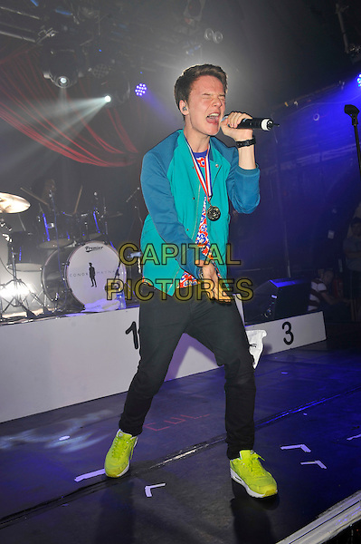 Conor Maynard.performing at G-A-Y, Heaven Nightclub, London, England, UK, 28th July 2012..music concert live on stage full length blue green jacket microphone singing red print t-shirt neon yellow trainers .CAP/MAR.© Martin Harris/Capital Pictures.