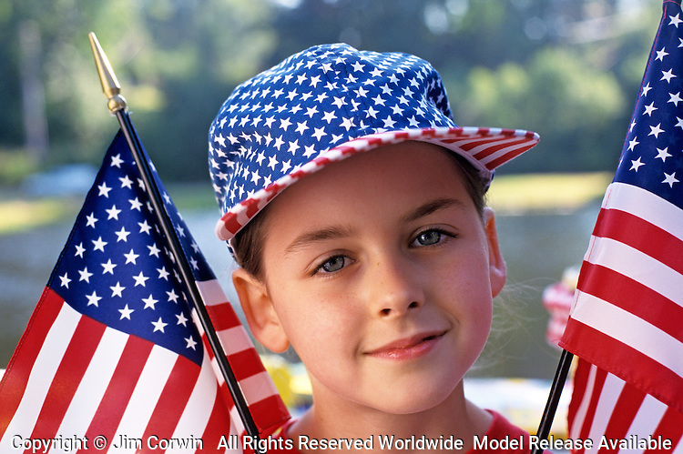 Girl ( 9 years old) at picnic with American flag baseball cap, looking at camera with American flag, portrait, Lake Pleasant, Bothell, Washington State USA   MR