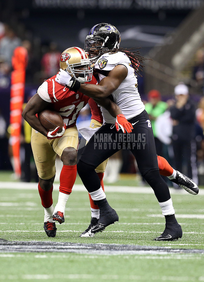Feb 3, 2013; New Orleans, LA, USA; San Francisco 49ers running back Frank Gore (21) is tackled by Baltimore Ravens inside linebacker Dannell Ellerbe in the first half in Super Bowl XLVII at the Mercedes-Benz Superdome. Mandatory Credit: Mark J. Rebilas-