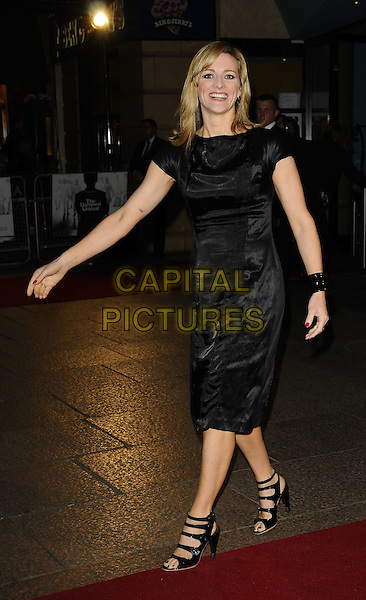 "GABBY LOGAN .World Premiere of ""The Damned United"" at the Vue West End, Leicester Square, London, England..March 18th 2009.full length gaby black dress patent cuff bracelet strappy shoes sandals open toe.CAP/CAN.©Can Nguyen/Capital Pictures."