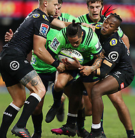 DURBAN, SOUTH AFRICA - MAY 05: Cameron Wright and S'busiso Nkosi of the Cell C Sharks tackle Aaron Smith of the Pulse Energy Highlanders during the Super Rugby match between Cell C Sharks and Highlanders at Jonsson Kings Park Stadium in Durban, South Africa on Saturday, 5 May 2018. Photo: Steve Haag / stevehaagsports.com