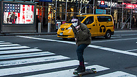 NEW YORK, NEW YORK - MARCH 4: A man wears a face mask as skates around Times Square on March 4, 2020 in New York City. The coronavirus cases in New York has been doubled to 22. Eight new victims testing positive state wide Gov. Cuomo announced Thursday..(Photo by Pablo Monsalve / VIEWpress)