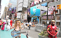 NEW YORK, NY - JUNE 21: The Naked Cowgirl and costumed character in the green zone on the first day of NYPD (New York Police Department) enforcement of the new pedestrian zones in Times Square where costumed characters and those selling bus or show tickets are required to solicit only in the designated green zone in New York, New York on June 21, 2016.  Photo Credit: Rainmaker Photo/MediaPunch