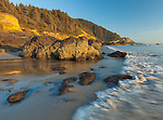 Ecola State Park, Oregon<br /> Evening light on surf of Indian beach and the forested Pacific coastal headlands