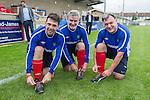 © Joel Goodman - 07973 332324 . 22/09/2013 . Lancing , UK . L-R Andy Burnham , Clive Efford and Ed Balls ' tying their rainbow laces , worn in support of an anti homophobia in football campaign . Labour Party vs journalists football match . Day 1 of the Labour Party 's annual conference in Brighton . Photo credit : Joel Goodman