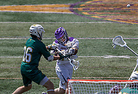 Vermont defender Spencer Decker (#26) blocks a shot as UAlbany Lacrosse defeats Vermont 14-4  in the American East Conference Championship game at Casey Stadium, May 5.