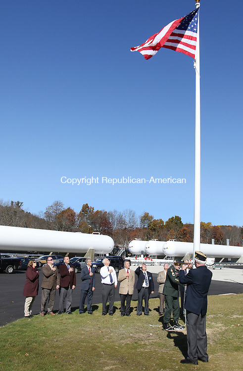 PLYMOUTH CT. 26 October 2015-102615SV09-Town officials and company executives participate in a flag-raising ceremony for the soft opening of Inland Fuels, a propane distribution company that will become the town's second largest taxpayer, in Plymouth Monday.<br /> Steven Valenti Republican-American