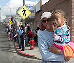 Baron and 4-year-old Stella watch the Reno Rodeo Parade held in Midtown on Virginia Street on Saturday, June 18, 2016.
