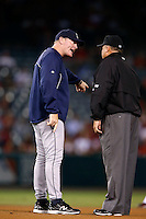 Seattle Mariners Manager Eric Wedge #22 argues with umpire Feldin Culbreth before a game against the Los Angeles Angels at Angel Stadium on September 26, 2012 in Anaheim, California. Los Angeles defeated Seattle 4-3. (Larry Goren/Four Seam Images)