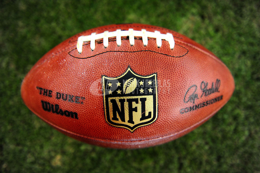 Aug. 27, 2011; Glendale, AZ, USA; Detailed view of an NFL football sitting on the sidelines prior to the game between the Arizona Cardinals against the San Diego Chargers during a preseason game at University of Phoenix Stadium. Mandatory Credit: Mark J. Rebilas-