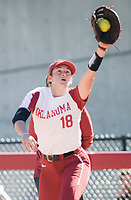 NWA Democrat-Gazette/CHARLIE KAIJO An Oklahoma first baseman catches the ball during a softball match, Sunday, October 28, 2018 at Bogle Park, University of Arkansas in Fayetteville.<br />
