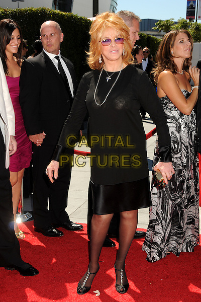 ANN-MARGRET ( OLSEN ).62nd Annual Primetime Creative Arts Emmy Awards - Arrivals held at Nokia Theatre L.A. Live, Los Angeles, CA, USA, 21st August 2010..emmys arrivals full length dress long sleeve black silver cross necklace tinted glasses sunglasses pink lenses .CAP/ADM/BP.©Byron Purvis/AdMedia/Capital Pictures.