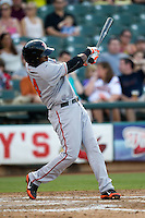 Fresno Grizzlies outfielder Francisco Peguero #14 swings during the Pacific Coast League baseball game against the Round Rock Express on May 19, 2012 at The Dell Diamond in Round Rock, Texas. The Grizzlies defeated the Express 10-4. (Andrew Woolley/Four Seam Images).