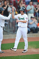 Cedar Rapids Kernels Sean Miller (4) celebrates with a teammate after a home run during the game against the Clinton LumberKings at Veterans Memorial Stadium on April 16, 2016 in Cedar Rapids, Iowa.  Cedar Rapids won 7-0.  (Dennis Hubbard/Four Seam Images)