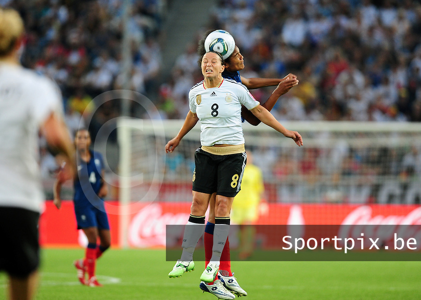 Fifa Women's World Cup Germany 2011 : France - Germany ( Frankrijk - Duitsland ) at Munchengladbach World Cup stadium : Inka GRINGS in duel met Wendie RENARD.foto DAVID CATRY / Vrouwenteam.be