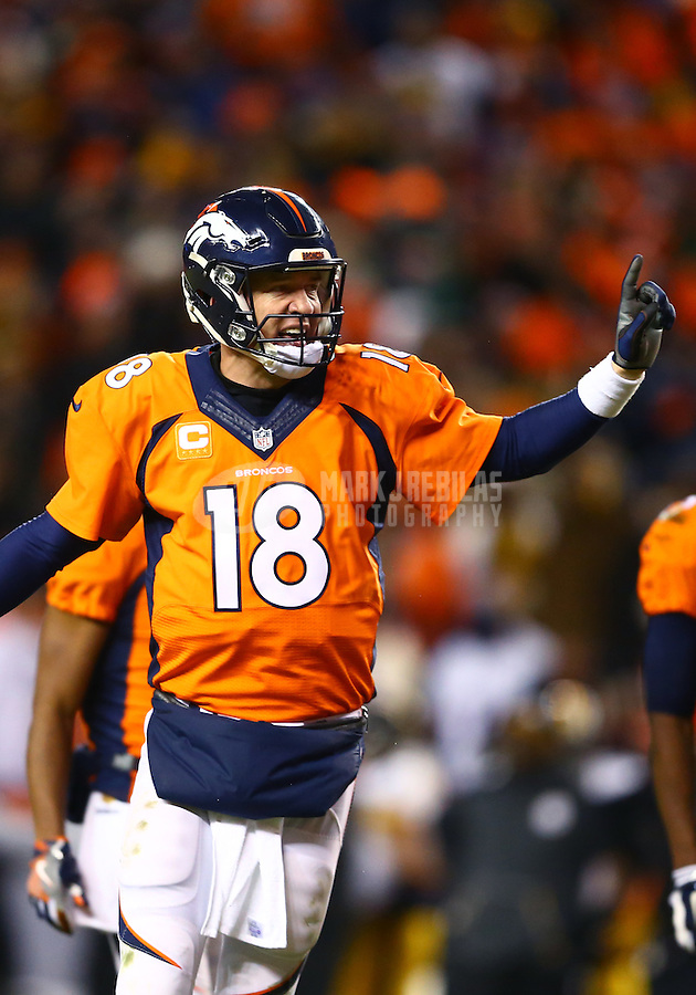 Jan 17, 2016; Denver, CO, USA; Denver Broncos quarterback Peyton Manning (18) reacts as he calls a play against the Pittsburgh Steelers during the AFC Divisional round playoff game at Sports Authority Field at Mile High. Mandatory Credit: Mark J. Rebilas-USA TODAY Sports