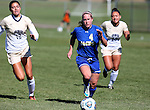 BROOKINGS, SD - OCTOBER 9:  Shelby Raper #4 from South Dakota State University pushes the ball past Brooklyn Eardley #10 and Chablee Sanders #23 from Oral Roberts during their game Sunday afternoon at Fischback Park in Brookings. (Photo by Dave Eggen/Inertia)