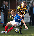 Alloa's Edward Ferns is challenged by Cowdenbeath's Thomas O'Brien.