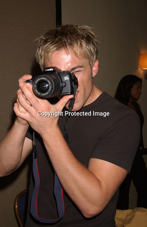 ..John Paul Lavoisier photographing his parents..at the One Life To Live Fan Club Luncheon on August 9,2003 at the Marriott Marquis Hotel. Photo by Robin Platzer, Twin Images