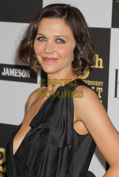 MAGGIE GYLLENHAAL .25th Annual Film Independent Spirit Awards - Arrivals held at the Nokia Event Deck at L.A. Live, Los Angeles, California, USA, 5th March 2010..indie portrait headshot grey gray one shoulder black make-up beauty strap .CAP/ADM/MJ.©Michael Jade/AdMedia/Capital Pictures.