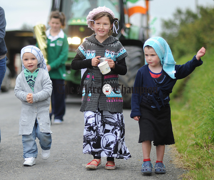 Nathan Morgan with Leah and Jamie Farrelly taking part in the Cree Parade during the rose of Clare Festival. Photograph by Declan Monaghan