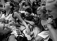 Skyline High School's basketball team dogpiles on Liz Johnson (15, bottom) after Johnson hit a last second shot to beat Davis and send Skyline to Saturday's State Championship game. Taylorsville - Skyline defeats Davis High School with a shot at the buzzer, 5A Girls State Basketball Championships at Salt Lake Community College.