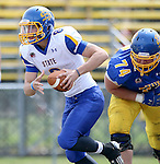 BROOKINGS, SD - APRIL 26: Quarterback Dalton Douglas #8 from South Dakota State's offense scrambles past Kellen Soulek #74 from the defense during their spring game Saturday at Coughlin Alumni Stadium in Brookings. (Photo by Dave Eggen/Inertia)
