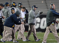California head coach Sonny Dykes is pictured clapping with his players during the game against Colorado at Folsom Field in Boulder, Colorado on November 16th, 2013.  Colorado defeated California, 41-24.