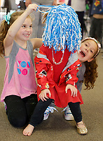 NWA Democrat-Gazette/DAVID GOTTSCHALK  Stella Sarna (center), 4, has her head covered in a pom pom Wednesday, March 21, 2018, by Anna Jackson (left), 7, and Kyle Campbell, 7, after her crown was stolen in the play production with TheareSquared of The Case of the Missing Crown during Camp Sequoyah - Spring Break 2018 at Mount Sequoyah in Fayetteville. The three day camp offered sessions in Food and Fitness, Art and Drama and Sport and Outdoor.