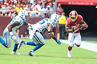 Landover, MD - September 16, 2018: Washington Redskins running back Chris Thompson (25) avoids a tackle during the  game between Indianapolis Colts and Washington Redskins at FedEx Field in Landover, MD.   (Photo by Elliott Brown/Media Images International)