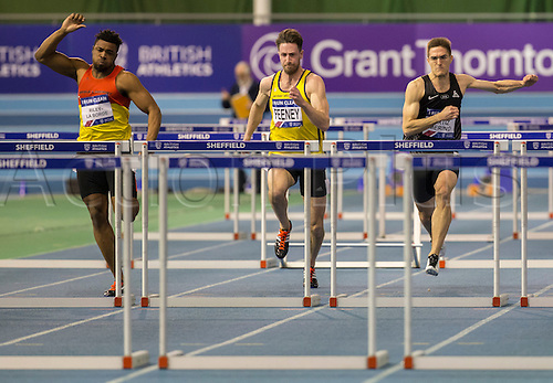27.02.2016. EIS Sheffield, Sheffield, England. British Indoor Athletics Championships Day One. Kia Riley-La Borde (Enfield & Haringey Harriers) (Left) comes through strong to gain second place in the Men's 60m Hurdles.