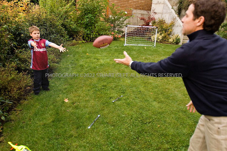 10/24/2006--Seattle, WA, USA..8 year old Clark Perry plays with his mother and father, David and Lauri Perry, in the family's garden in Seattle. Clark was diagnosed with autism when he was 3 1/2 years old...Photograph By Stuart Isett.All photographs ©2006 Stuart Isett.All rights reserved.