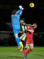 Crawley Town's Glenn Morris clears the danger from Exeter City's Ollie Watkins during the Sky Bet League 2 match between Crawley Town and Exeter City at Broadfield Stadium, Crawley, England on 28 February 2017. Photo by Carlton Myrie / PRiME Media Images.