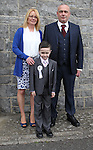 Derek Morris pictured on his  communion day in Duleek with his parents Valarie and Derek.