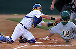 SIOUX FALLS, SD - MAY 22: Catcher Sam Pack #8 from South Dakota State puts the tag on Jon Hechtner #19 from North Dakota State at home plate in the first inning Thursday night in the first round of the Summit League Baseball Tournament in Sioux Falls. (Photo by Dave Eggen/Inertia)