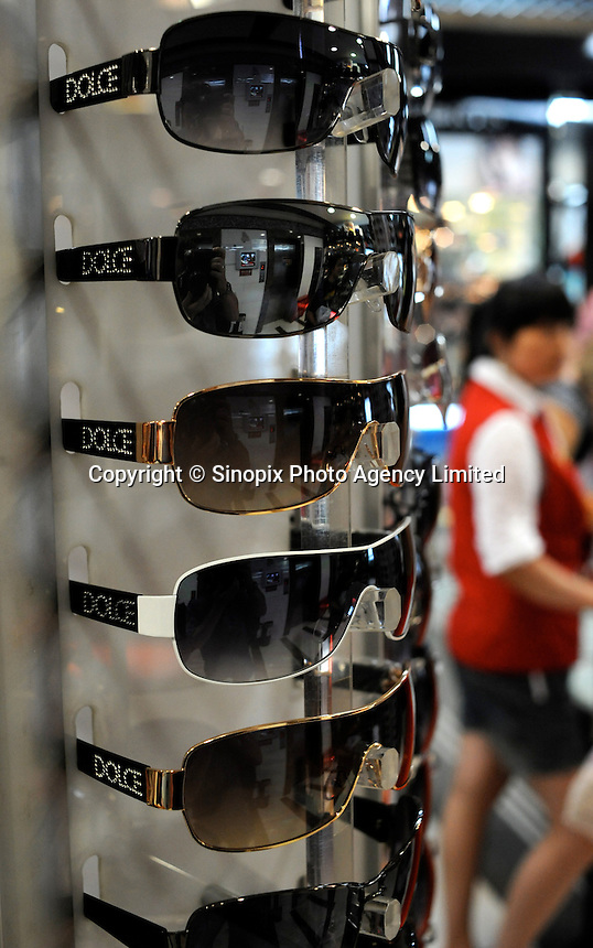 Fake Doce and Gabanna sunglasses sale at the silk Market. The &quot;Silk Market&quot; in Central Beijing is proving a major tourist attraction with thousands of Olympic tourists flocking there daily in order to purchase fake designer goods ranging from clothing to watches.  The Beijing authorities closed hundreds of night-clubs and introduced many restriction on and rules ahead of the 2008 Olympics in the city mysteriously has allowed the trade of fake goods to foreigners continue, thumbing their nose at western companies.<br />