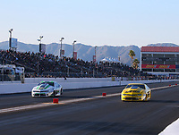 Feb 23, 2019; Chandler, AZ, USA; NHRA pro stock driver Kenny Delco (left) races alongside Jeg Coughlin Jr during qualifying for the Arizona Nationals at Wild Horse Pass Motorsports Park. Mandatory Credit: Mark J. Rebilas-USA TODAY Sports