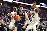 WINSTON-SALEM, NC - FEBRUARY 24: Notre Dame's Matt Farrell (5) and Wake Forest's Terrence Thompson (20). The Wake Forest University Demon Deacons hosted the University of Notre Dame Fighting Irish on February 24, 2018 at Lawrence Joel Veterans Memorial Coliseum in Winston-Salem, NC in a Division I men's college basketball game. Notre Dame won the game 76-71.