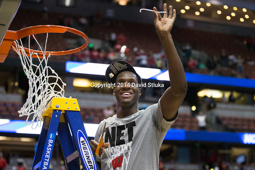 Wisconsin Badgers Nigel Hayes cuts down a piece of the net after the Western Regional Final NCAA college basketball tournament game against the Arizona Wildcats Saturday, March 29, 2014 in Anaheim, California. The Badgers won 64-63 (OT). (Photo by David Stluka)