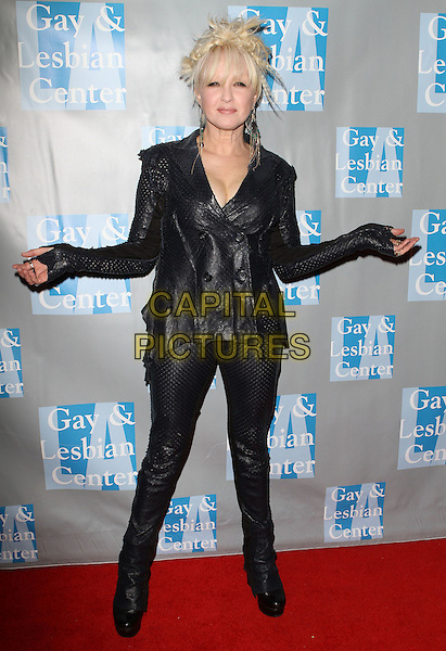 "CYNDI LAUPER .L.A. Gay & Lesbian Center's ""An Evening With Women"" held at The Beverly Hilton Hotel, Beverly Hills, California, USA..April 16th, 2011.full length  black hands arms leather trousers jacket .CAP/ADM/KB.©Kevan Brooks/AdMedia/Capital Pictures."