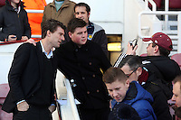 Pictured: Swansea manager Michael Laudrup (L) poses for a picture with a fan. 01 February 2014<br /> Re: Barclay's Premier League, West Ham United v Swansea City FC at Boleyn Ground, London.